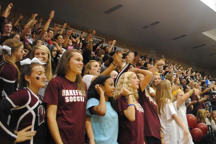 Students shout in support of their cheerleaders during the Freshman/Sophomore pep rally.