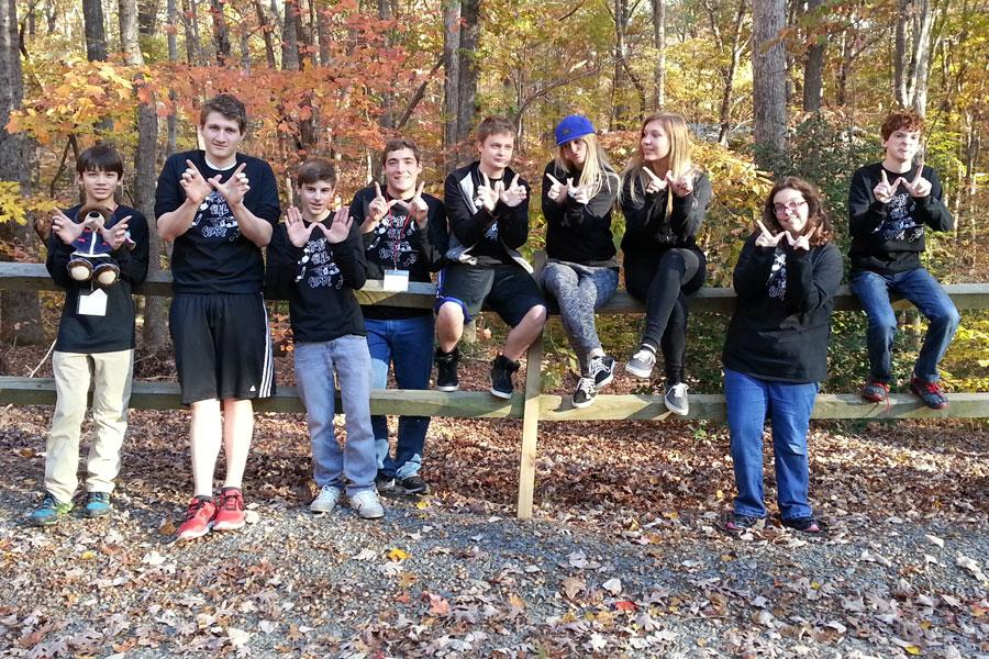 Students represent the 'W' as they participate in German Immersion Weekend at Camp Caraway.