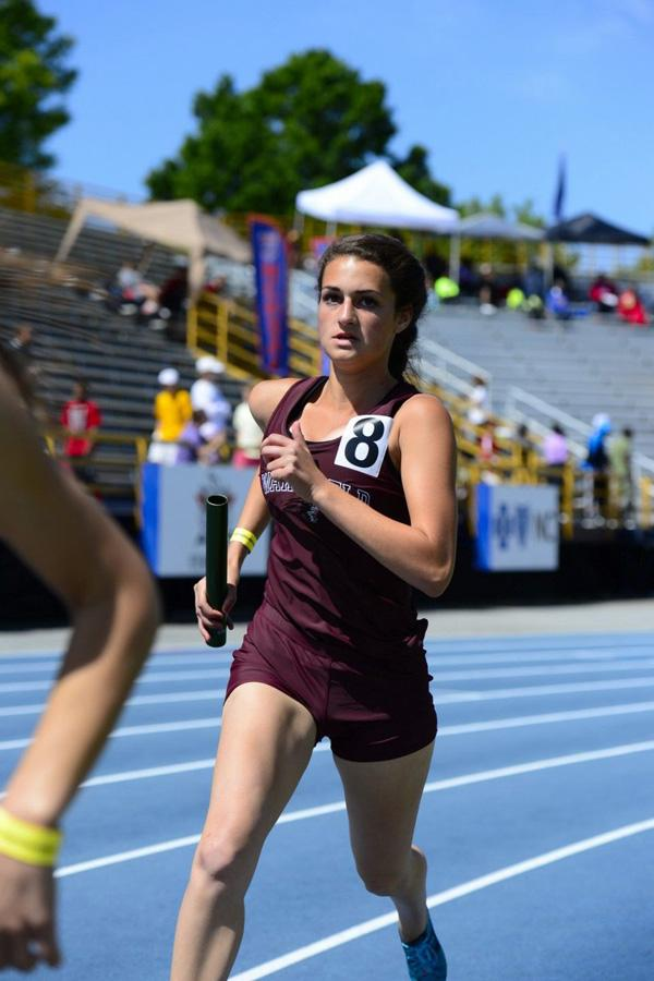 Wakefield runner Angela Delfino wields a baton during a recent relay event.