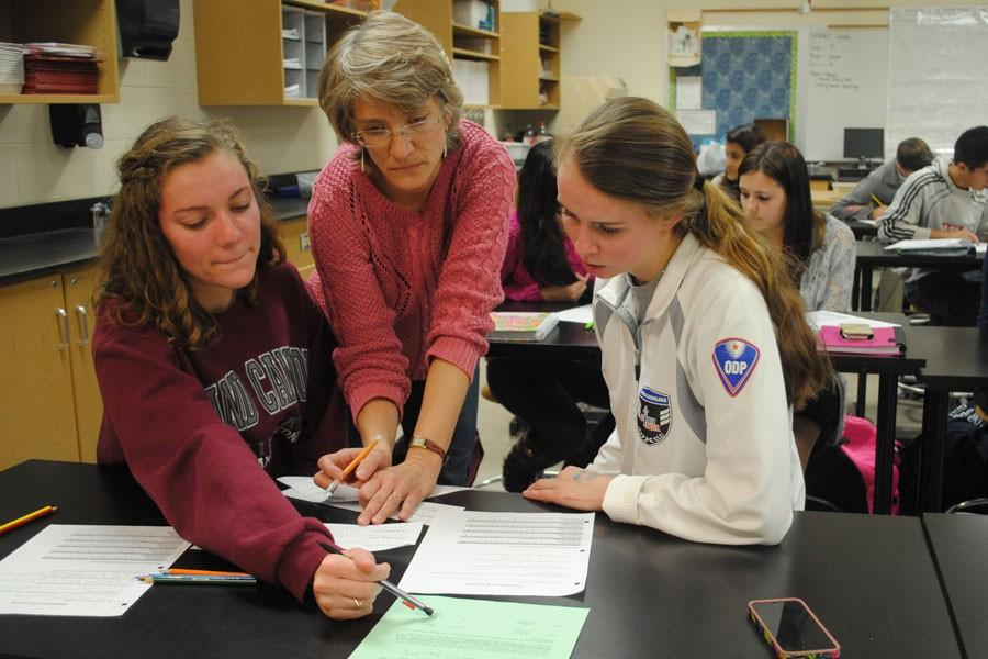 Stiles engages with AP Biology Students Sydeny Jones and Ashley Stardford.