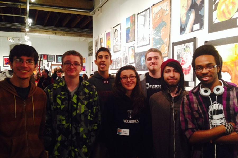 Wakefield students posing in front of their artwork at First Friday. Photo Courtesy of Dawn Valentino
