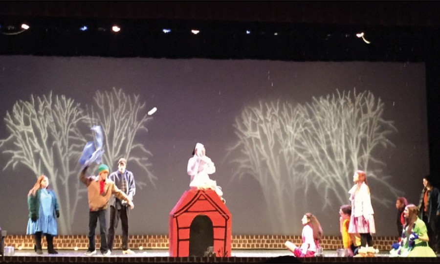 The cast of Charlie Brown throw snowballs during the one act show A Charlie Brown Christmas.