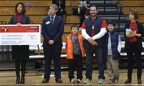 Just Think First adviser Tony Calabria and Sandy Gasper look on as State Farm  representatives present the $100,000 check.