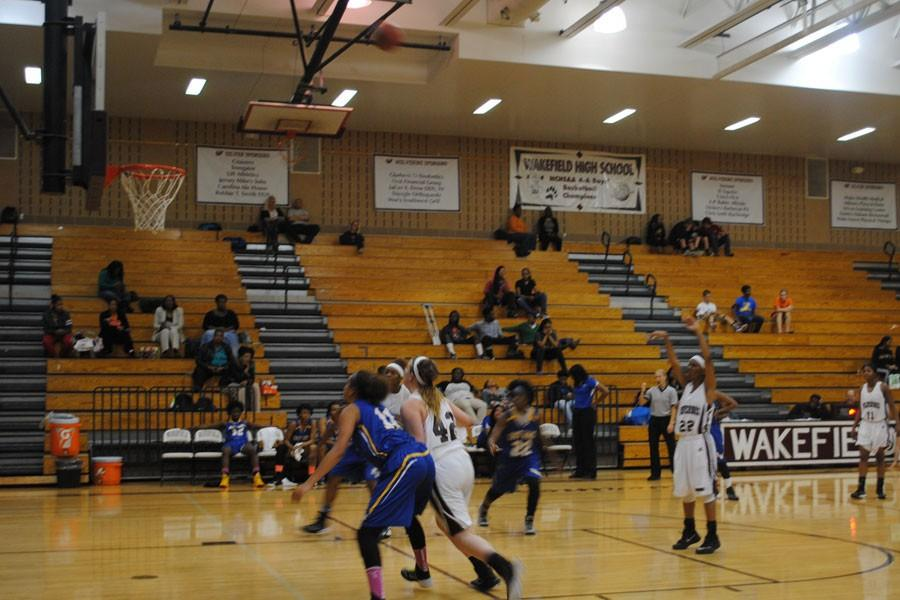 Senior TeliyahWarren shoots a free throw while her teamates battle for a rebound against East Wake.