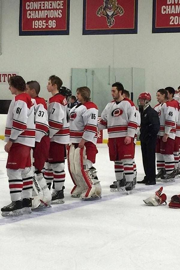 Junior Hurricanes get ready to face off on the ice.
