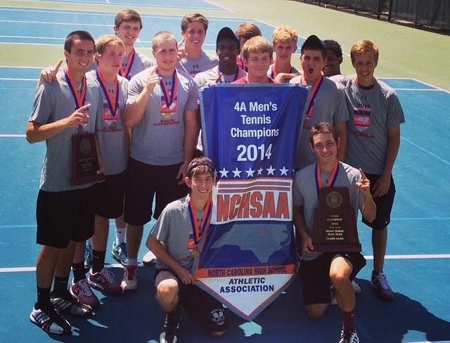 Mens tennis team celebrates with their trophy after winning states last year.