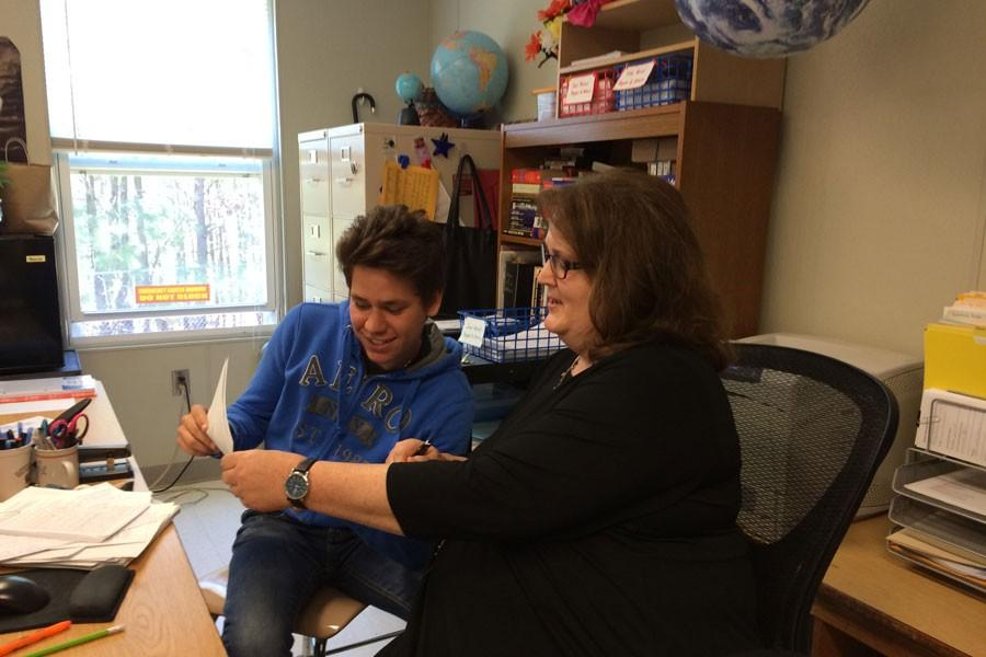 Ms. Schock works with an APUSH student.