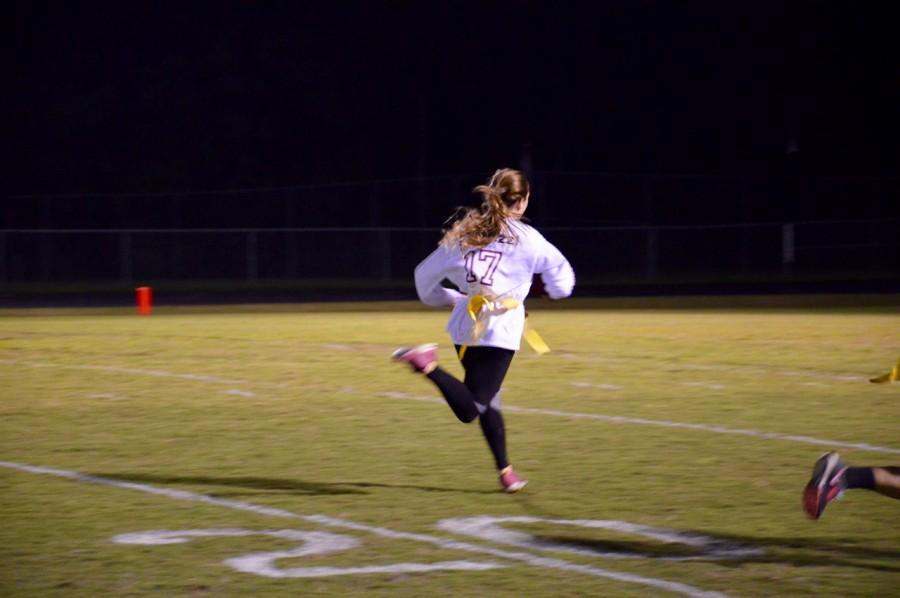 Lauren+Monroe%28Junior%29%2C+breaks+free+for+a+touchdown+run+during+the+powderpuff+game.