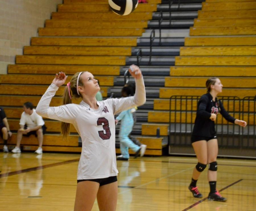 Senior Erin Fox warms up before the teams match against Sanderson.