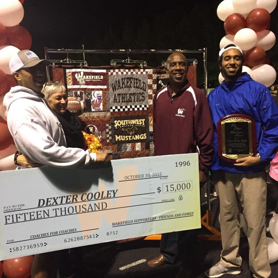 Dexter Cooley along with his wife, Nancy and sons, Michael and Phillip received the check raised after the golf tournament in his honor.