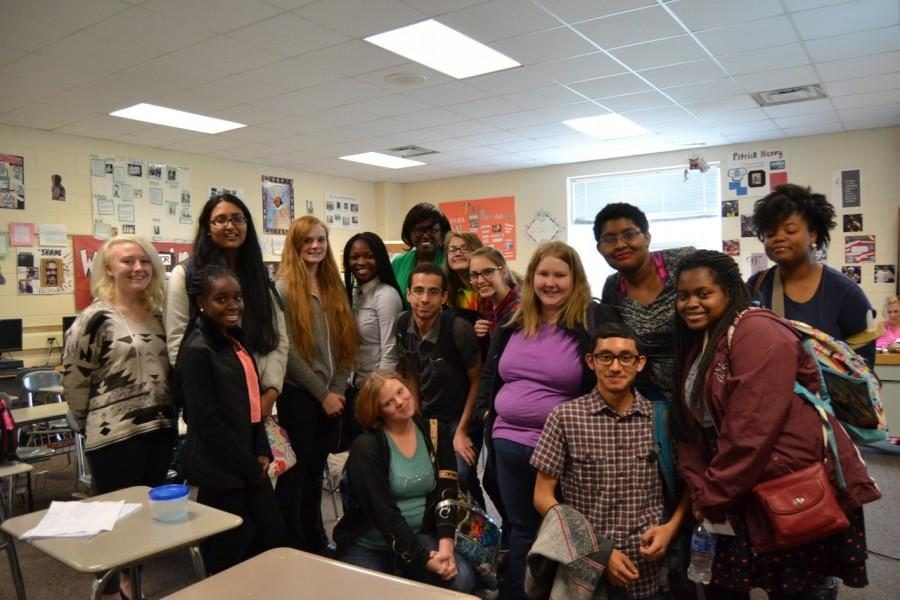 Members of the anti-bullying club gather around for a group photo during anti-bullying week.