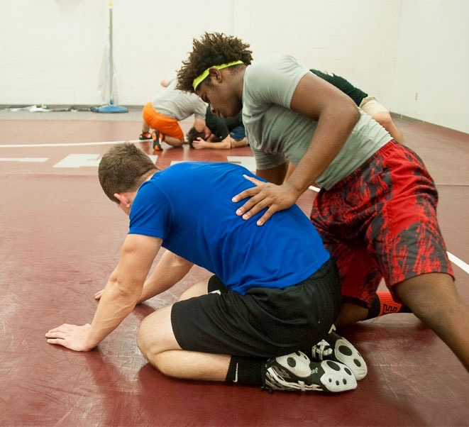 Wrestlers practice daily to prepare for their matches.