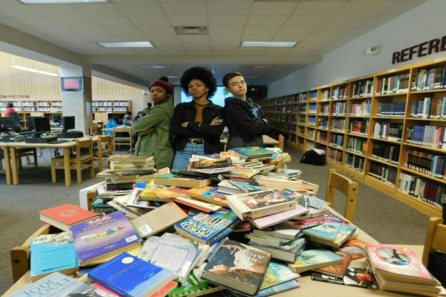Students sort books raised by the African Library Project.