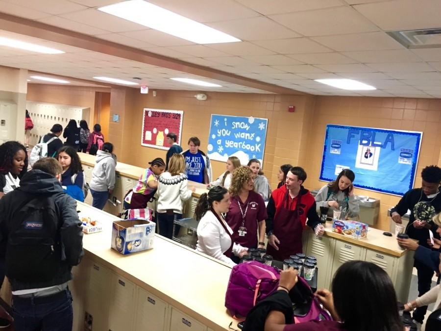 Students gather in the 200 locker bay after first period to get a warm cup of coffee.