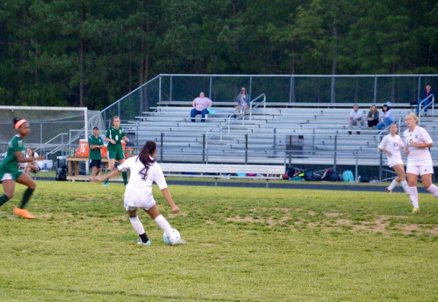 Senior, Laney Badulis clears the ball out of the defensive zone.