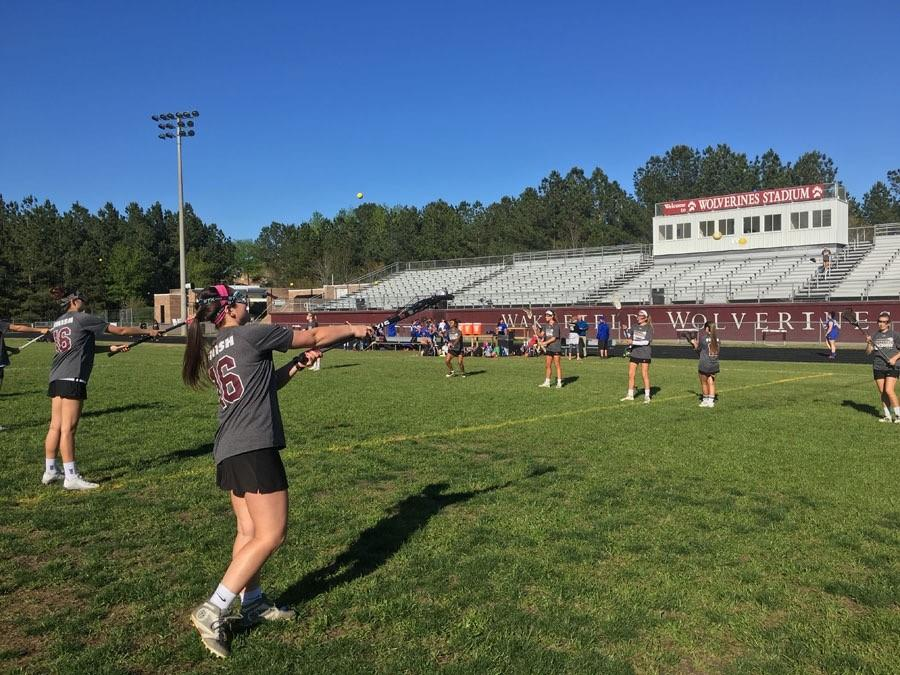 The women's lacrosse warms up before their game.