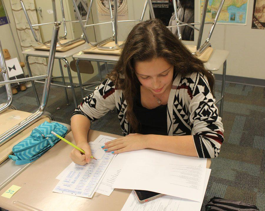 A freshman taking a test in World History during smart lunch.