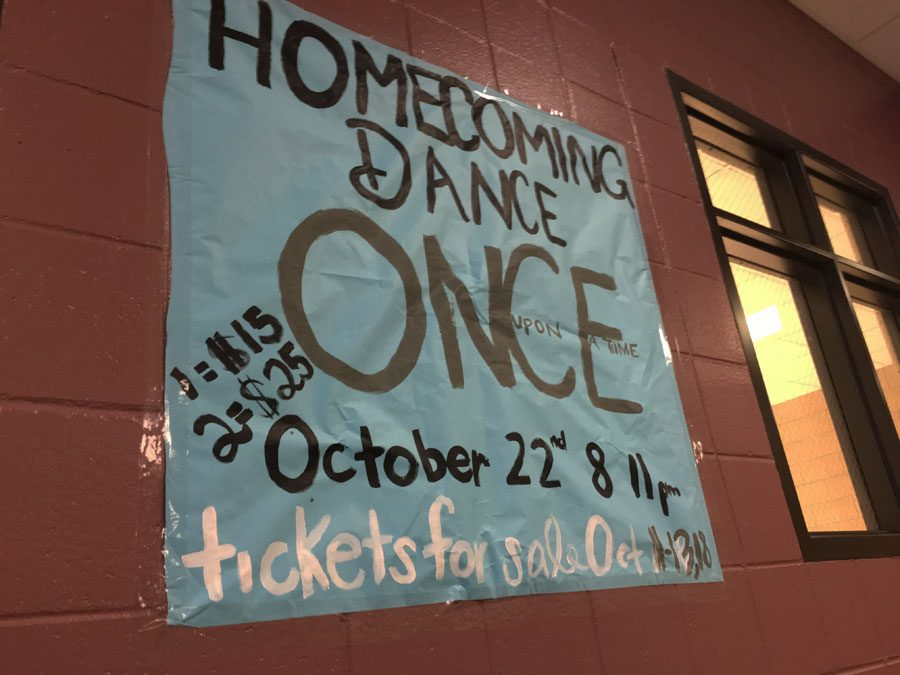A poster advertises for the upcoming homecoming dance.