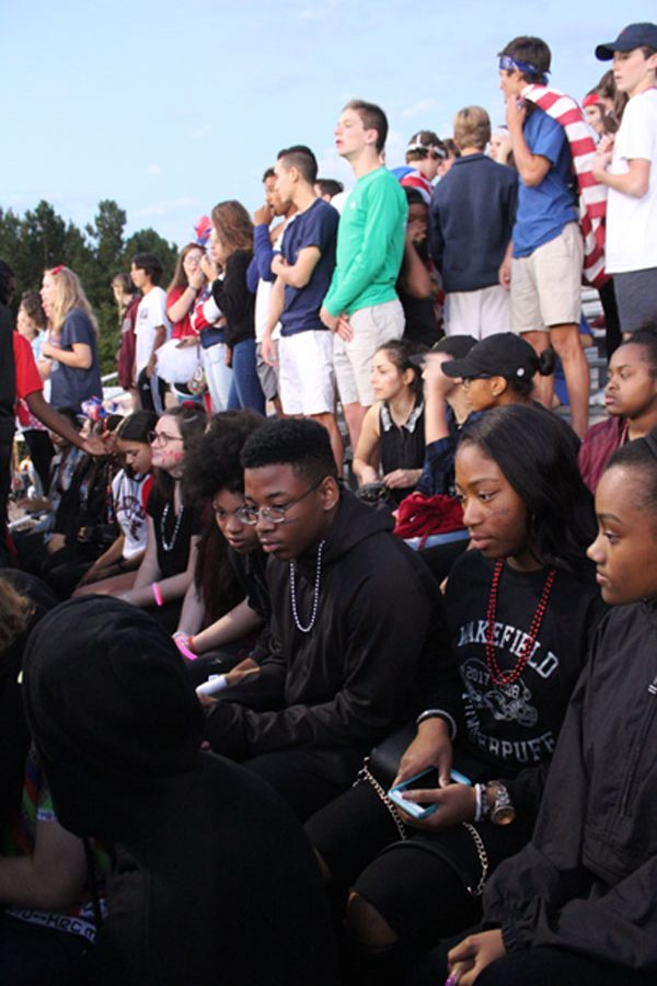 Black Student Union getting ready to silently protest the national anthem.
