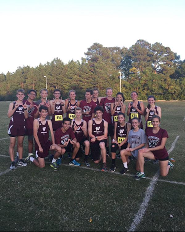 The Wakefield Cross Country team celebrates their completion of the Cap-8 competition.