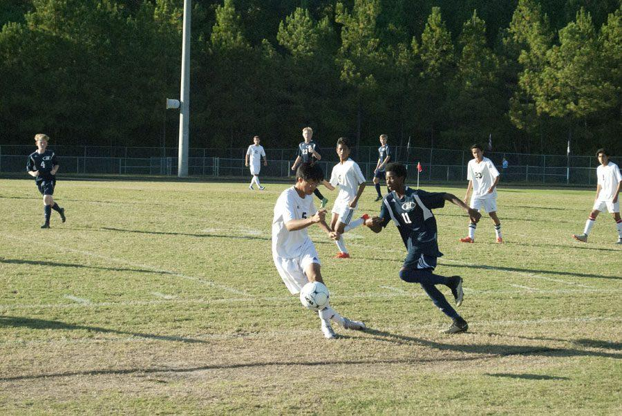 Wakefield's Junior Varsity player steals the ball away from Heritage player.