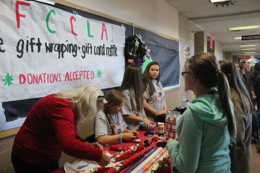 Members of FCCLA wrap presents for customers.