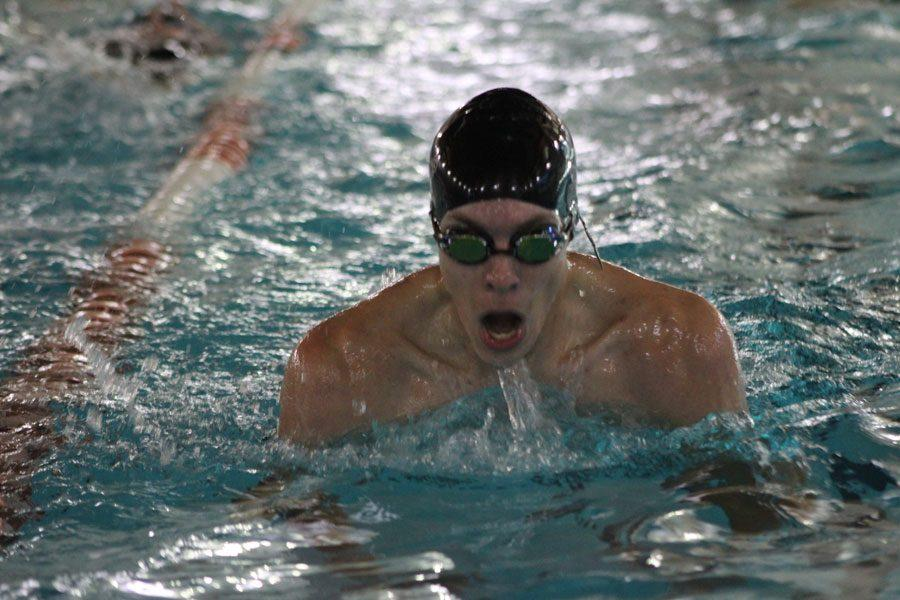 Garrison Wolford refines his breaststroke during practice.