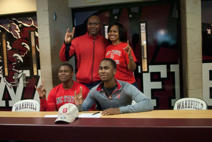 Matt McKay shows Pack pride during Wakefield's fall signing event.