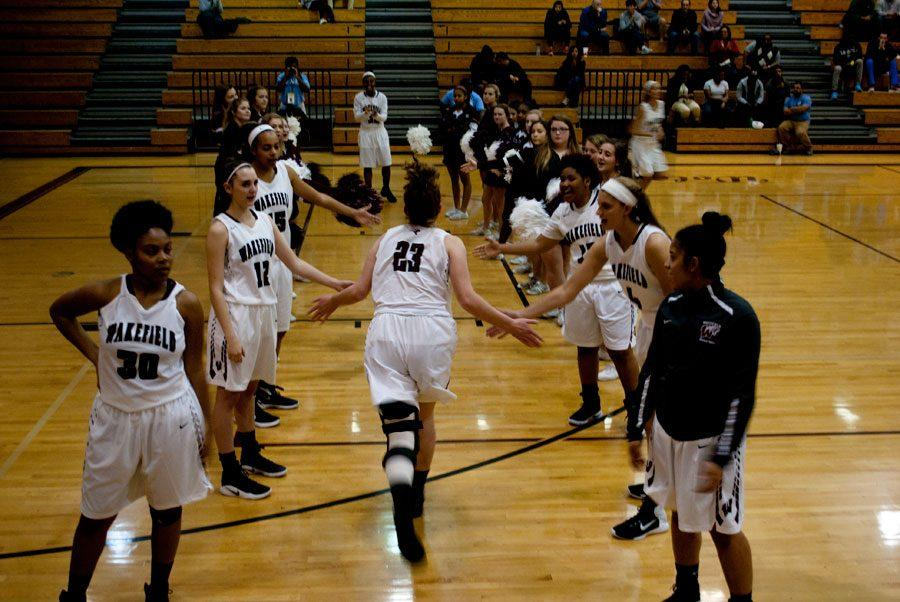 Junior, Mary Butler receiving high-fives before the start of the game.