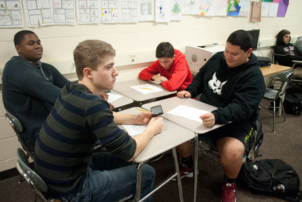 Students in Ms. Goodson's fourth period English review a packet in preparation for their final exam.
