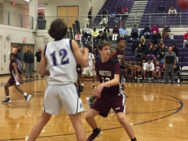 Freshman, #22 Colby Parcell defends against #12 from Broughton.