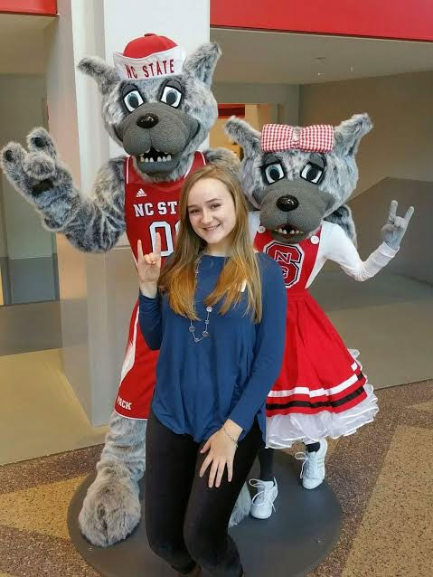 Senior, Natalie Collier parks herself next to some future friends at NC State.