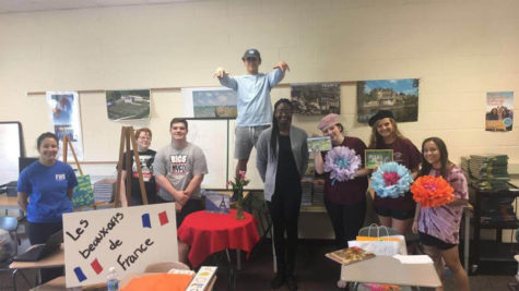 Students in French Honor Society practice their French skills for French Immersion weekend.