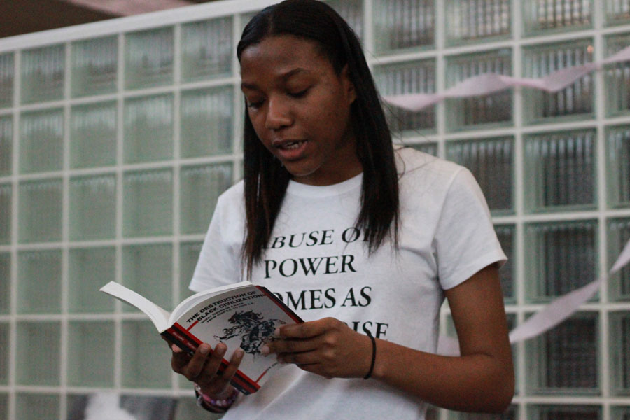 Junior, Kariamu Joesph reads