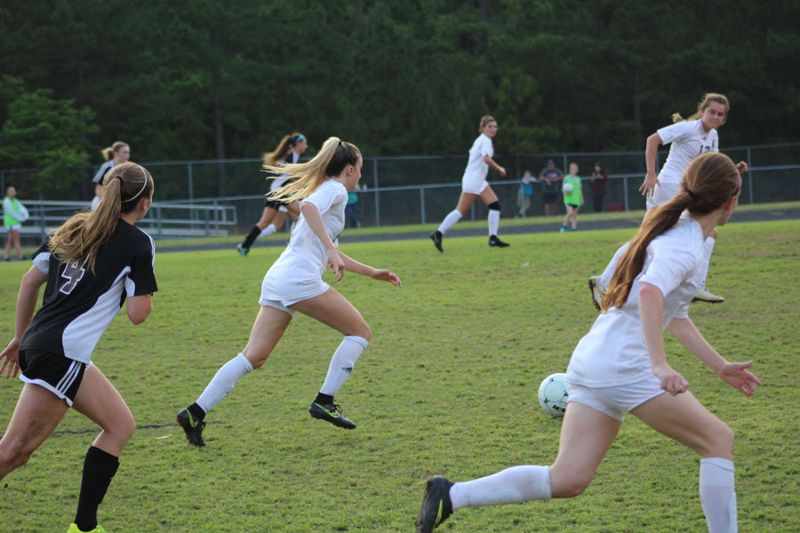Hailey Stone pursues the ball against Harnett Central High.