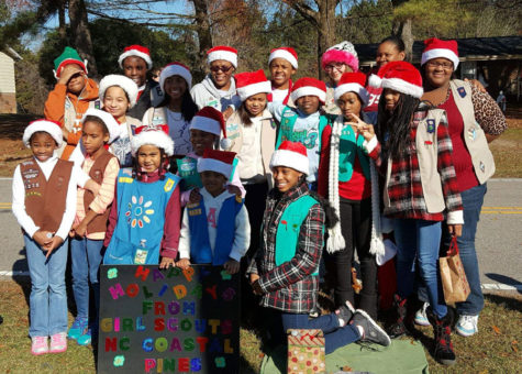 Troop Leader Sophia Morning and Troop 1075 pose at the 2016 Knightdale Christmas Parade.