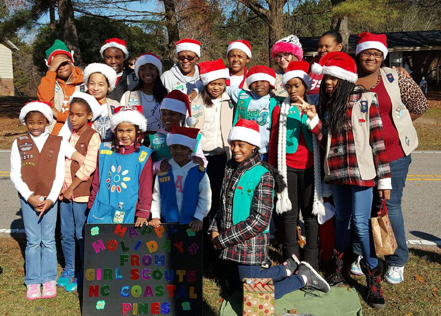 Troop+Leader+Sophia+Morning+and+Troop+1075+pose+at+the+2016+Knightdale+Christmas+Parade.