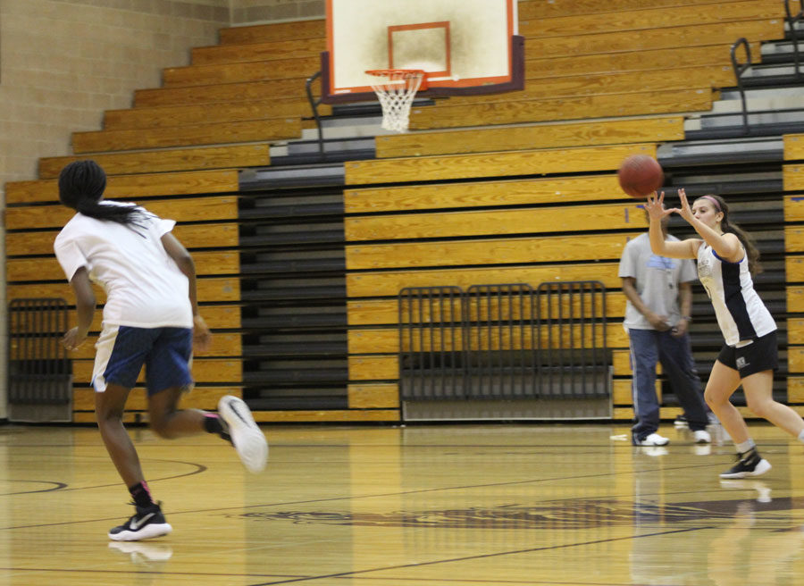 Members of the Lady Wolverines work on passing drills during practice.