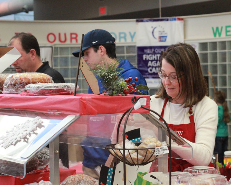 Volunteers help out with the bake sale at Mistletoe Market.