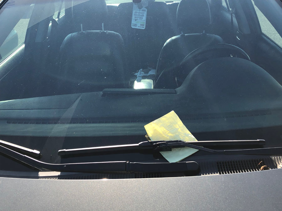 Students returning to poorly parked cars in the student parking lot dread the yellow ticket.