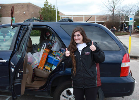 Senior, Macy Bonnet poses with the donations she collected for Beta Club