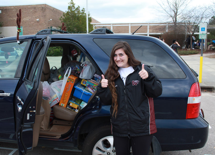 Senior, Macy Bonnet poses with the donations she collected for Beta Club's Christmas drive.