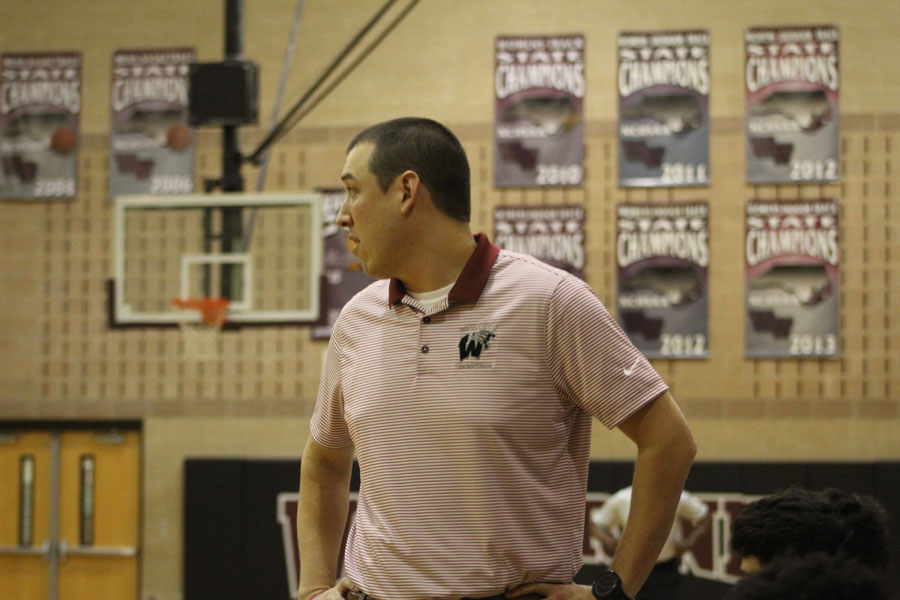 Coach Stevens monitors players on the court.