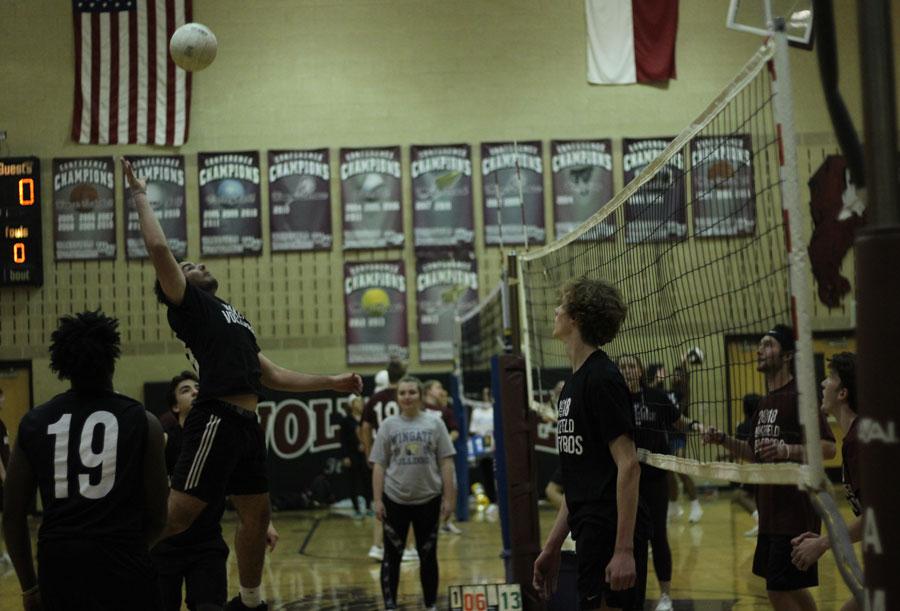 Junior, Ben Kiernan goes up to attack the ball.