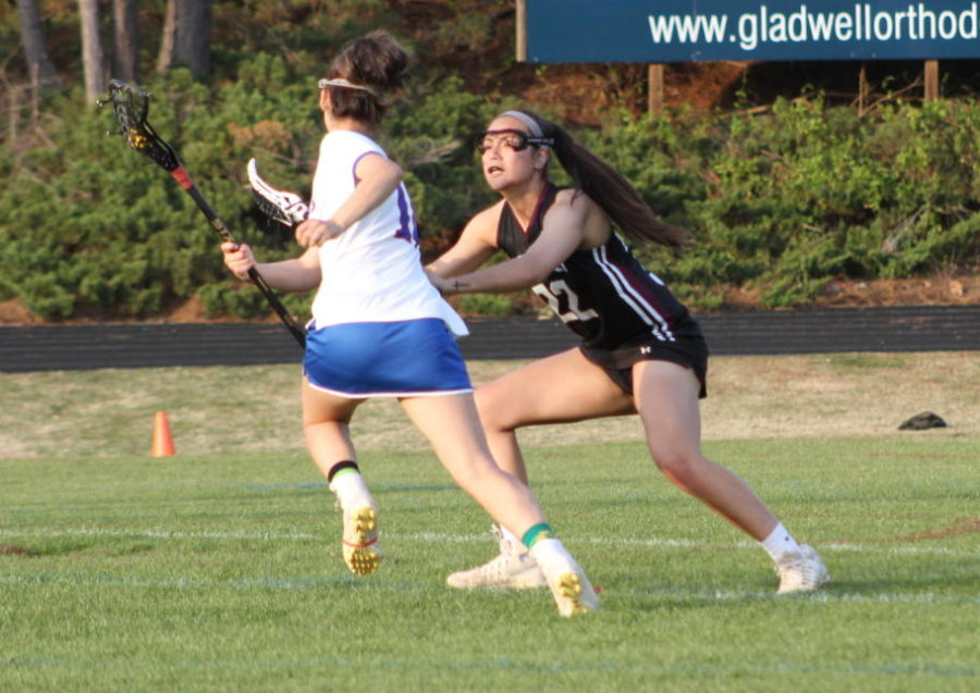 Senior, Jenna Chitla goes in to steal the ball.