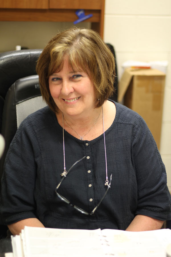 Dr. Wells spends her final days as an administrator before her retirement.