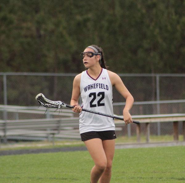 Senior, Jenna Chitla anticipating the opposing team's next movement.