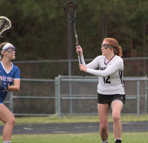 Senior, Mary Butler goes in to defend.