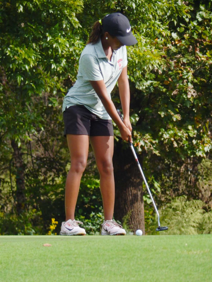 Senior Ryanne Howard, focusses to put the ball into the hole.
