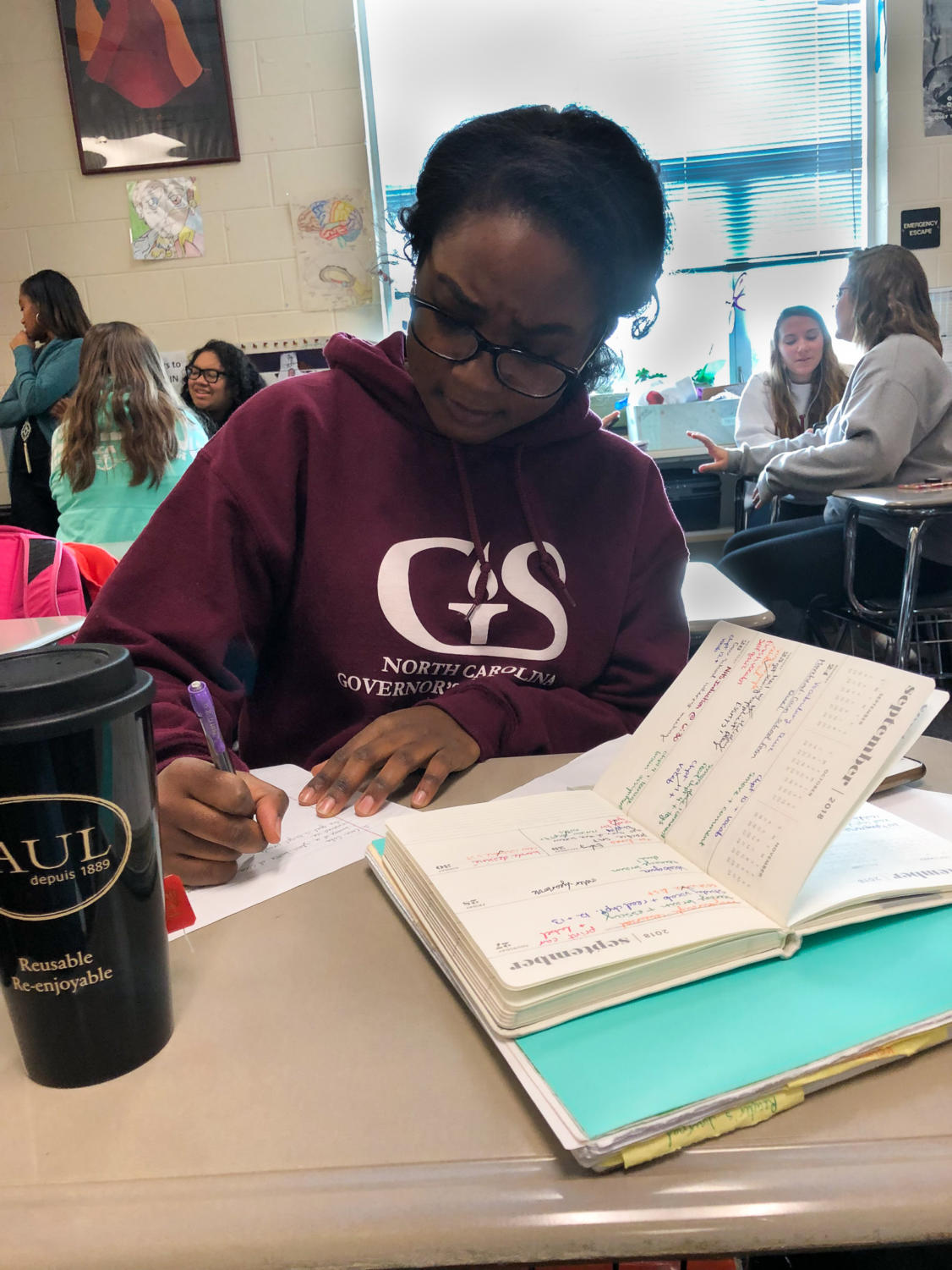 Senior Amani Bushiri schedules time for homework with her already packed schedule.